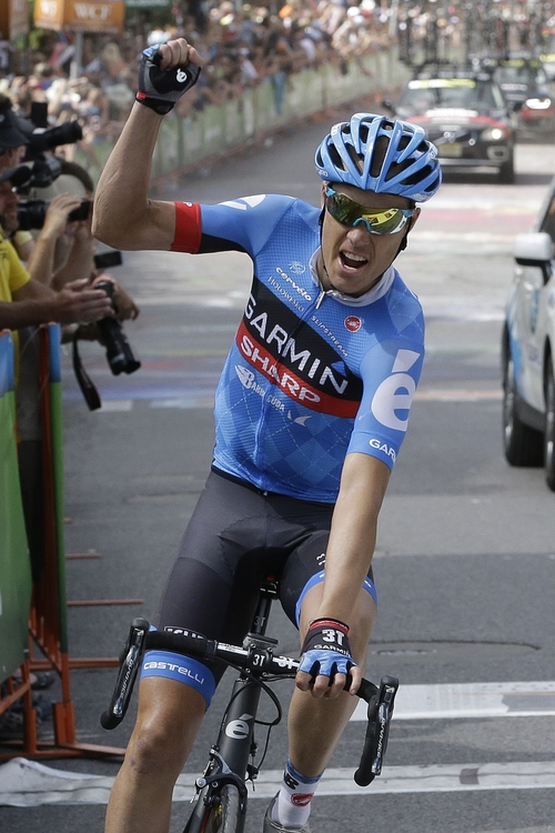 Thomas Danielson, of team Garmin-Sharp, celebrates after winning the overall Tour of Utah cycling race during Stage 6, Sunday, Aug. 11, 2013, in Park City, Utah. Danielson came in third place during the stage. (AP Photo/Rick Bowmer)