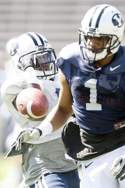 Chris Detrick     The Salt Lake Tribune Brigham Young Cougars defensive back Jordan Johnson (6) breaks up a pass intended for Brigham Young Cougars wide receiver Ross Apo (1) during the spring scrimmage at LaVell Edwards Stadium Saturday March 30, 2013.