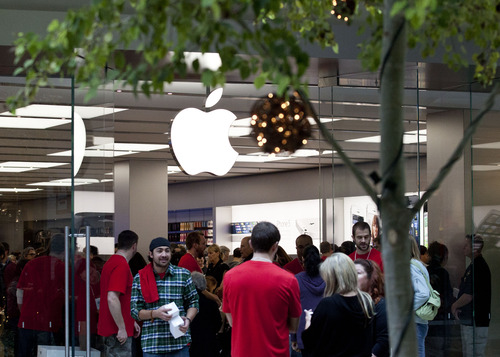 Lennie Mahler  |  The Salt Lake Tribune Shoppers collect free T-shirts as they enter the Apple store during its grand opening at City Creek Center mall in downtown Salt Lake City on Saturday, Nov. 17, 2012.