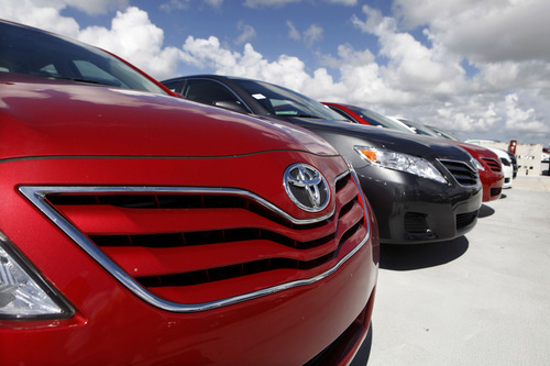 FILE- In this Thursday, Aug. 5, 2010, file photo a 2011 Toyota Camry LE sits on the lot at Kendall Toyota in Miami.  Toyota will not relinquish the Camry's spot as America's most popular car in 2013, a top executive told industry analysts on Tuesday, Aug. 2013.(AP Photo/Lynne Sladky, File)