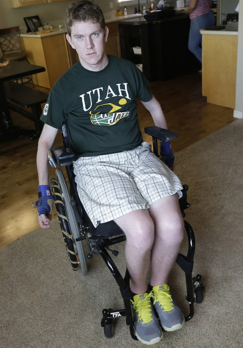 In this Wednesday, Aug. 7, 2013, photo, Stephen Merrill sits on his wheelchair at his home in Highland, Utah. Merrill was finishing his freshman year of college two years ago when he and a group of friends went to an indoor trampoline park in Utah for a day of flipping, jumping and bouncing. At one point, Merrill leaped from a platform into a pit full of foam blocks, and he shot right through the protective barriers and landed on his head on a trampoline and foam surface below. He broke a vertebra in his neck, and was left paralyzed from the neck down. (AP Photo/Rick Bowmer)