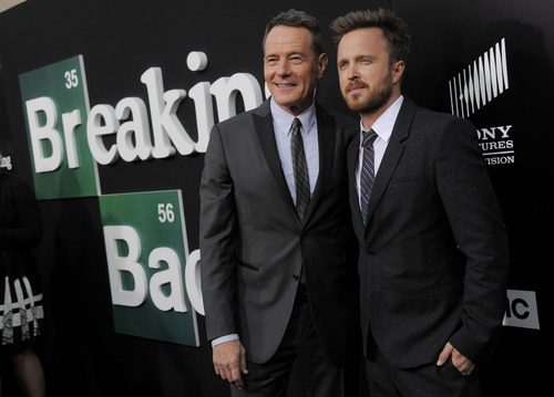 "Bryan Cranston, left, and Aaron Paul, cast members in ""Breaking Bad,"" pose together at a premiere screening to celebrate the final episodes of the television series at Sony Pictures Studios on Wednesday, July 24, 2013 in Los Angeles. (Photo by Chris Pizzello/Invision/AP)"