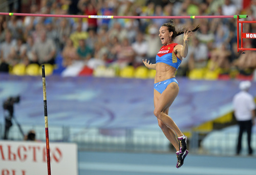 Russia's Yelena Isinbayeva clears the bar in the women's pole vault final at the World Athletics Championships in the Luzhniki stadium in Moscow, Russia, Tuesday, Aug. 13, 2013. (AP Photo/Martin Meissner)