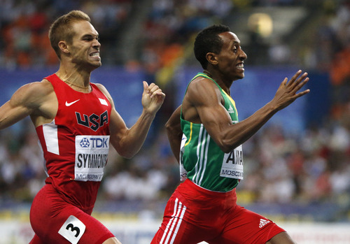 Ethiopia's gold medalist Mohammed Aman and United States' silver medalist Nick Symmonds, left, approach the finish line in the men's 800-meter final at the World Athletics Championships in the Luzhniki stadium in Moscow, Russia, Tuesday, Aug. 13, 2013. (AP Photo/Alexander Zemlianichenko)