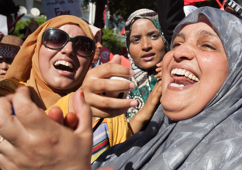 Tunisian women, who support the ruling moderate Islamic Ennahda Party, take part in a rally in Tunis, Tunisia, Tuesday Aug. 13, 2013. Supporters and opponents of Tunisia's Islamist-led government flooded the streets of the capital in rival rallies Tuesday marking national women's day. (AP Photo/Amine Landoulsi)