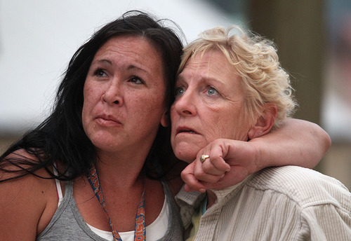 Pine residents Kylie Rivera, left, and Gloria Koch watch the approaching flames from the 80,000 acres Elk Complex FIre in Pine, Idaho, on Sunday Aug. 11, 2013. The Elk Complex Fire, has so far charred more than 125-square-miles and is now the nation's top wildfire priority, according to federal wildfire officials. (AP Photo/Times-News, Ashley Smith)  Mandatory  Credit
