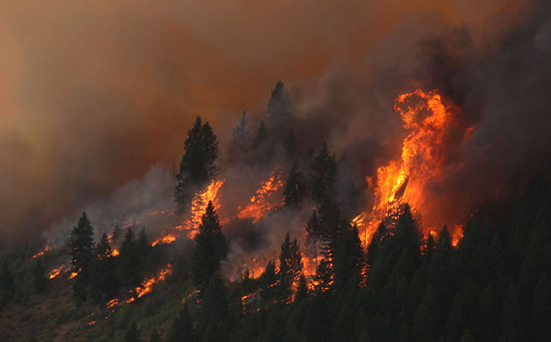 The 80,300-acre Elk Fire Complex burns across Elmore County, Idaho , Sunday Aug. 11, 2013.  The Elk Complex Fire has so far charred more than 125-square-miles and is now the nation's top wildfire priority, according to federal wildfire officials. (AP Photo/Times-News,Ashley Smith) Mandatory  Credit