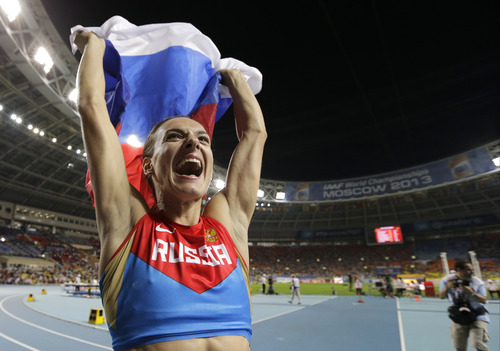 Russia's Yelena Isinbayeva celebrates winning the gold medal in the women's pole vault final at the World Athletics Championships in the Luzhniki stadium in Moscow, Russia, Tuesday, Aug. 13, 2013. (AP Photo/David J. Phillip)