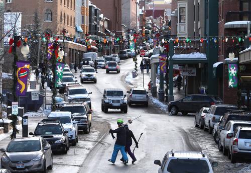 Rick Egan  |  The Salt Lake Tribune Skiers cross Main Street in Park CIty, Friday, December 28, 2012.
