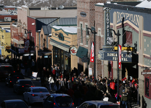 Festival goers line up outside of the Egyptian Theatre on Main Street during the 2013 Sundance Film Festival on Monday, Jan. 21, 2013 in Park City, Utah. (Photo by Danny Moloshok/Invision/AP)