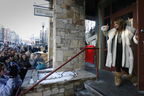 Rick Egan  | The Salt Lake Tribune   Jane Seymour peeks out of the LA Times on Main Street door to say hello to her fans on lower Main Street,  Saturday, January 19, 2013.
