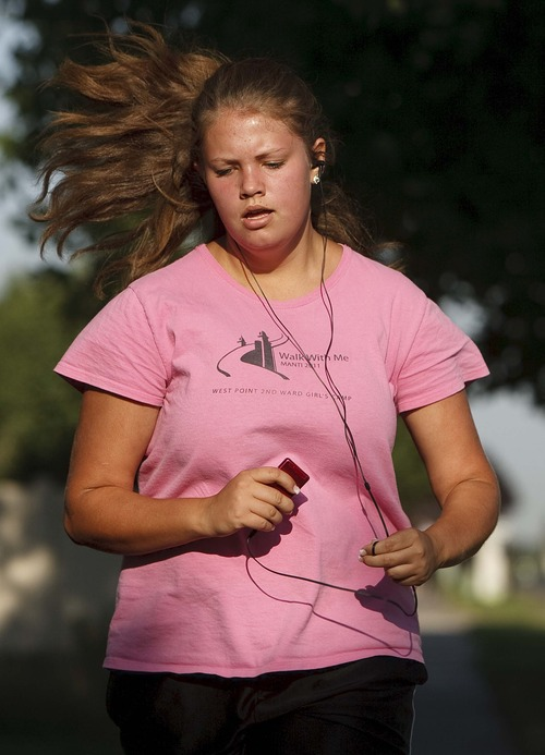 Leah Hogsten   The Salt Lake Tribune Julianne Orton, 15, jogs two miles with her mother and four siblings throughout their neighborhood Wednesday, Aug. 7, 2013. The Orton children go to online charter schools, which allows them to arise later every morning than peers in traditional schools, a plus for teenagers whose circadian rhythms make them nightowls.