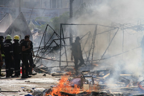 Firefighter attempt to put out fires as Egyptian security forces clear a sit-in by supporters of ousted Islamist President Mohammed Morsi in the eastern Nasr City district of Cairo, Egypt, Wednesday, Aug. 14, 2013. Egyptian security forces, backed by armored cars and bulldozers, moved on Wednesday to clear two sit-in camps by supporters of the country's ousted President Mohammed Morsi, showering protesters with tear gas as the sound of gunfire rang out at both sites. (AP Photo/Ahmed Gomaa)
