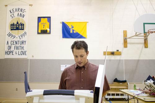 Jeremy Harmon  |  The Salt Lake Tribune  Seth Horowitz votes at the Kearns-St. Ann Catholic school in Salt Lake City on Tuesday, August 13, 2013.