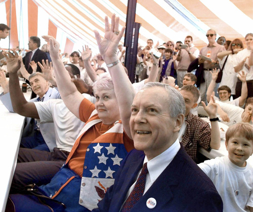 Cliff Shiappa     AP file photo Republican presidential hopeful Orrin Hatch, foreground, smiles as his wife, Elaine, shown seated next to Hatch, and others follow the directions of an entertainer performing at a Hatch for President rally in Ames, Iowa, prior to the Iowa Straw Poll Saturday, Aug. 14, 1999.