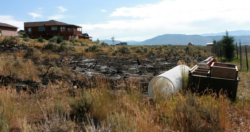 Burned area around home at Rockport Estates as seen Wednesday August 14.   Photo by homeowner Pat Pike