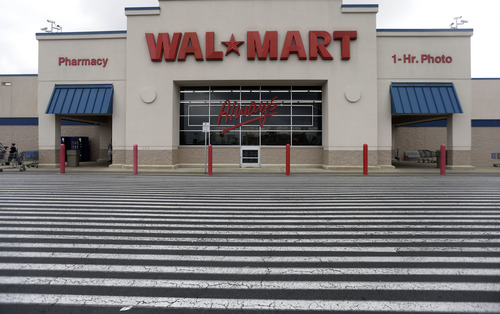 This  July 12, 2013, photo, shows a Wal-Mart,  in Bristol, Pa.  Wal-Mart Stores Inc. reports quarterly financial results on Thursday, Aug. 15, 2013. (AP Photo/Matt Rourke)