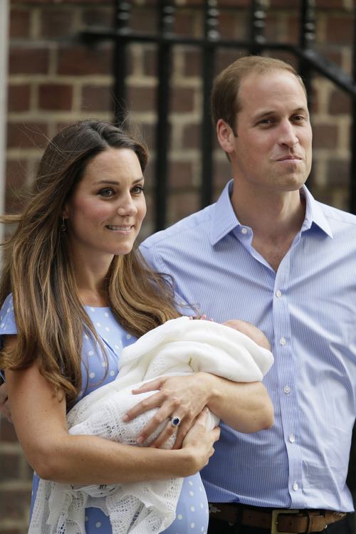 Britain's Prince William, right, and Kate, Duchess of Cambridge hold the Prince of Cambridge, Tuesday July 23, 2013, as they pose for photographers outside St. Mary's Hospital exclusive Lindo Wing in London where the Duchess gave birth on Monday July 22. The boy, who is third in line to the British throne, has since been named George Alexander Louis by his parents and will be known as Prince George of Cambridge. (AP Photo/Alastair Grant)