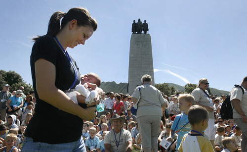 Scott Sommerdorf   |  The Salt Lake Tribune Sheridan Orton of Lehi, holds three week-old  Scott Orton - an eighth generation descendant of Joseph Smith Sr., the father of the LDS church founder. Over 700 descendants gathered for a family portrait at the foot of the This is the Place memorial Saturday at This is the Place Heritage Park, Saturday, August 3, 2013.