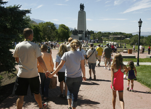 Scott Sommerdorf   |  The Salt Lake Tribune Descendants of Joseph Smith Sr., the father of the LDS church founder, move to gather at the foot of the memorial at This is the Place Heritage Park, Saturday, August 3, 2013. A photo was made of over 700 descendants.
