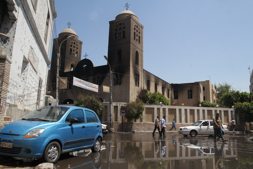 The damaged Prince Tadros Church is seen a day after it was torched in sectarian violence following the dispersal of two Cairo sit-ins of supporters of the ousted Islamist President Mohammed Morsi, in Minya, south of Cairo, Egypt, Thursday, Aug. 15, 2013. Egypt faced a new phase of uncertainty on Thursday after the bloodiest day since its Arab Spring began, with hundreds of people reported killed and thousands injured as police smashed two protest camps of supporters of the deposed Islamist president. Wednesday's raids touched off day-long street violence that prompted the military-backed interim leaders to impose a state of emergency and curfew, and drew widespread condemnation from the Muslim world and the West, including the United States. (AP Photo/Roger Anis, El Shorouk Newspaper) EGYPT OUT