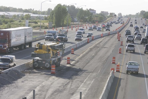 Tribune file photo The massive I-15 reconstruction project through Utah County in July 2010. Transportation officials say orange cones will return to the highway in force next spring.