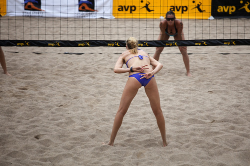 Jim McAuley | The Salt Lake Tribune  Kerri Walsh Jennings signals to her teammate Whitney Pavlik as they serve against Jennifer Fopma and Brooke Sweat at the AVP Salt Lake City Open beach volleyball tournament at Liberty Park on Saturday, August 17, 2013.