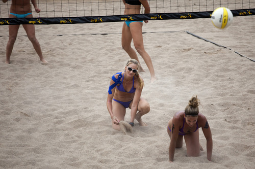 Jim McAuley | The Salt Lake Tribune  Kerri Walsh Jennings, left, and Whitney Pavlik fall short of winning a volley against Jennifer Fopma and Brooke Sweat near the end of a match at the AVP Salt Lake City Open beach volleyball tournament at Liberty Park on Saturday, August 17, 2013.