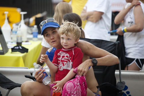 Jim McAuley | The Salt Lake Tribune  Kerri Walsh Jennings greets her four-year-old son Joseph Michael Jennings after losing in the AVP Salt Lake City Open beach volleyball tournament at Liberty Park on Saturday, August 17, 2013.