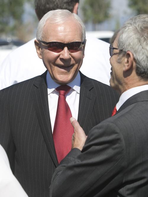 Rick Egan  | The Salt Lake Tribune   Senator Orrin Hatch laughs with Salt Lake City Mayor Ralph Becker  at the grand opening ceremonies for the new Draper TRAX line.Friday, August 16, 2013.