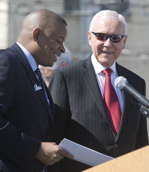 Rick Egan  |  The Salt Lake Tribune U.S. Department of Transportation Secretary Anthony Foxx talks on Friday with Senator Orrin Hatch, at the grand opening ceremonies for the new Draper TRAX line.