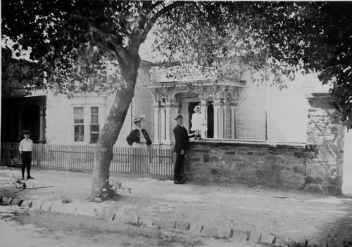 Salt Lake Tribune archive  A home of Lorenzo Snow, fifth president of the LDS Church. The little boy is not identified, but the lady behind the picket fence was Mrs. J.O. Duke. the man was L.T. Peirce, a Brigham City merchant, and the little girl on the stone wall was Eleanor Duke.