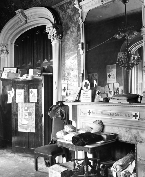 Salt Lake Tribune archive  Interior of the home of Alfred William McCune in Salt Lake City. The home, located on north Main Street, cost $500,000 to build in 1901. McCune was a very successful business man with ventures in railroad and mining. He was a partner in the Peruvian Cerro de Pasco mines along with J. P. Morgan, William Randolph Hearst, and Frederick William Vanderbilt. McCune wanted his home to be extravagant. The McCune home site was chosen to rise up impressively over the nearby streets, and little expense was spared on decoration. McCune had materials shipped from San Domingo, England and South Africa. The red roof tiles came from Holland, and an enormous broad mirror wall was transported from Germany in a specially made railroad car. The walls were adorned with moiré silks, tapestries, and Russian leather. The exterior of the home was built of red Utah sandstone although some details like the lavish fireplaces used more exotic stone like Nubian marble.
