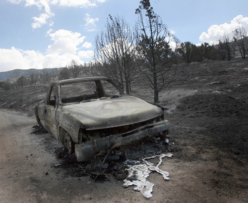 Rick Egan  | The Salt Lake Tribune   A truck destroyed by the fire near Terra, Utah, Saturday, August 17, 2013.