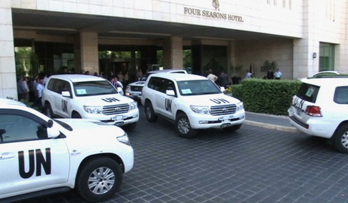 In this image made from video, U.N. vehicles leave the entry area of a hotel after U.N. weapon inspectors get off their vehicles upon their arrival in Damascus, Syria, Sunday, Aug. 18, 2013. A team of U.N. weapons inspectors arrived in Damascus on Sunday for a long-delayed mission to investigate the alleged use of chemical arms in Syria's civil war. (AP Photo/AP Video)
