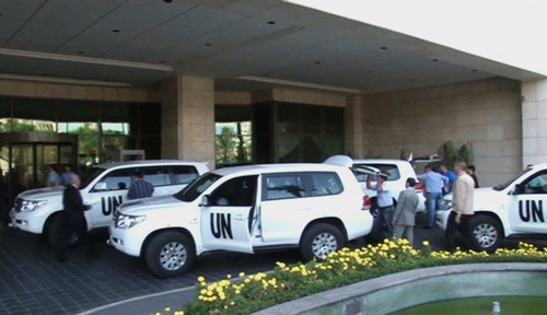 In this image made from video, U.N. weapon inspectors gets off their vehicles as they arrive at a hotel in Damascus, Syria, Sunday, Aug. 18, 2013. A team of U.N. weapons inspectors arrived in Damascus on Sunday for a long-delayed mission to investigate the alleged use of chemical arms in Syria's civil war. (AP Photo/AP Video)
