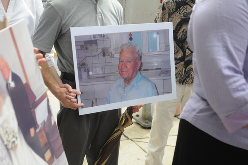 In an Aug. 1, 2013 photo, family members in support of Barbara J. Mancini, 57, of Philadelphia, hold pictures of Joseph Yourshaw, 93, of Pottsville, after Mancini's preliminary hearing before Magisterial District Justice James K. Reiley in Pottsville, Pa. Mancini is accused of giving a bottle of morphine to her dying father, 93-year-old Joe Yourshaw of Schuylkill County, and has become the latest lightening rod in the nation's long-running debate over assisted suicide. (AP PhotoNick Meyer/The Republican-Herald, Nick Meyer)