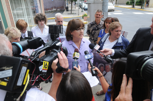 In an Aug. 1, 2013 photo, Gwen Fitzgerald, director of communications and marketing for Compassion and Choices, nonprofit organization committed to helping everyone have the best death possible, speaks in support of Barbara J. Mancini, 57, of Philadelphia, after Mancini's preliminary hearing before Magisterial District Justice James K. Reiley in Pottsville, Pa.  Mancini is accused of giving a bottle of morphine to her dying father, 93-year-old Joe Yourshaw of Schuylkill County, and has become the latest lightening rod in the nation's long-running debate over assisted suicide. (AP Photo/The Republican-Herald, Nick Meyer)