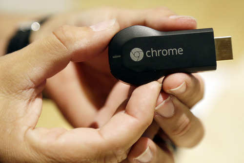 The new Google Chromecast device is shown on Wednesday, July 24, 2013, in San Francisco. (AP Photo/Marcio Jose Sanchez)