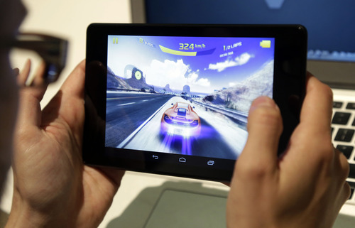 A video game is played on the new Nexus 7 tablet during a Google event on Wednesday, July 24, 2013, in San Francisco. (AP Photo/Marcio Jose Sanchez)