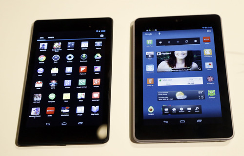 The new Nexus 7 tablet is shown next to an older version during a Google event on Wednesday, July 24, 2013, in San Francisco. (AP Photo/Marcio Jose Sanchez)
