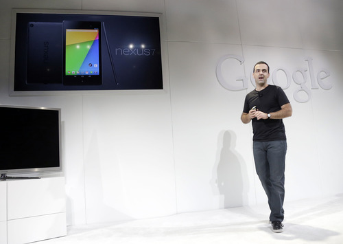Hugo Barra, vice president Android product management at Google, displays the new Nexus 7 tablet on Wednesday, July 24, 2013, in San Francisco. (AP Photo/Marcio Jose Sanchez)
