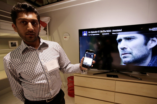 Suveer Kothari of Google demonstrates how a Chromecast media device can transfer web content from his Android device directly to a television at Dogpatch Studios in San Francisco, Calif. on Wednesday, July 24, 2013.  (Gary Reyes/Bay Area News Group)