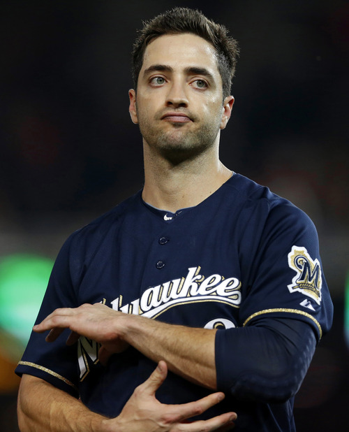"File- In this Sept. 21, 2012, file photo, Milwaukee Brewers' Ryan Braun reacting while holding his elbow after missing his swing during a baseball game against the Washington Nationals at Nationals Park, in Washington. Arizona Diamondbacks manager Kirk Gibson said Sunday, Aug. 18, 2013, that ""cheaters"" like Braun rob other players of opportunities for moments such as his pinch-hit home run for the Los Angeles Dodgers during the ninth inning of Game 1 of the 1988 World Series. (AP Photo/Jacquelyn Martin, File)"