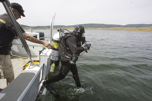 Keith Johnson | The Salt Lake Tribune  Department of Public Safety dive team member UHP Sgt. Wendell Nope participates in a training exercise at Strawberry Reservoir in Wasatch County, August 7, 2013. Members of the DPS dive team were training with two types of sonar they use in the search and recovery of drowning victims.