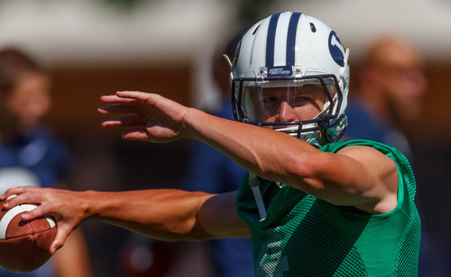 Trent Nelson  |  The Salt Lake Tribune Taysom Hill throws the ball at BYU football practice in Provo Saturday August 3, 2013.