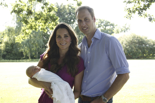 This image taken by Michael Middleton, the Duchess's father, in early August 2013 and supplied by Kensington Palace, shows the Duke and Duchess of Cambridge with their son, Prince George, in the garden of the Middleton family home in Bucklebury, England. (AP Photo/Michael Middleton/TRH The Duke and Duchess of Cambridge ) EDITORIAL USE ONLY
