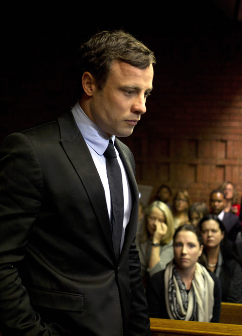 South African Olympian Oscar Pistorius appears in the magistrates court in Pretoria, South Africa, Monday, Aug. 19, 2013. Pistorius has arrived at the South African court ahead of the expected indictment of the double-amputee Olympian on a premeditated murder charge. (AP Photo/Themba Hadebe)