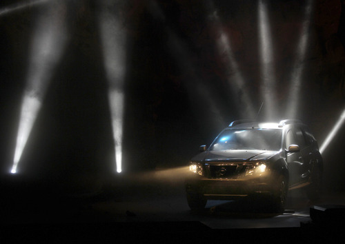 A Nissan new Terrano premium compact SUV is displayed during an unveiling ceremony in Mumbai, India, Tuesday, Aug 20, 2013. Terrano will be on market at Rupees One Million ($ 15,873) onwards. (AP Photo/Rafiq Maqbool)