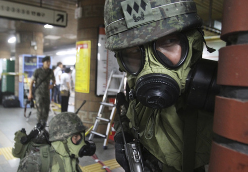 """South Korean army soldiers take part in South Korea-U.S. joint military exercise, """"Ulchi Focus Lens,"""" at a subway station in Seoul, South Korea, Tuesday, Aug. 20, 2013. North Korea on Tuesday criticized the drills with milder-than-usual language that's seen as a sign of its interest in keeping up diplomacy. (AP Photo/Ahn Young-joon)"""
